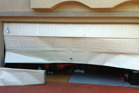 Major Damage Garage Door